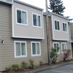 Outside of a multifamily property showing new windows.