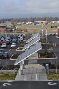 Solar panels on poles in the parking lot of the Rogue Valley Airport.