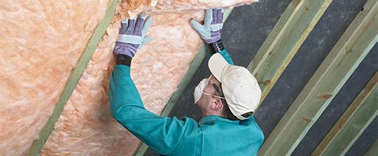 Contractor adding insulation.