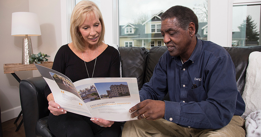 contractor and homeowner looking at paper