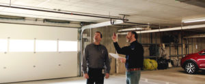 Contractor talking about lighting with participant.