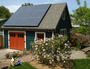 a garage with solar panels installed on the roof