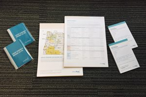 Photo of Existing Buildings collateral on a table.