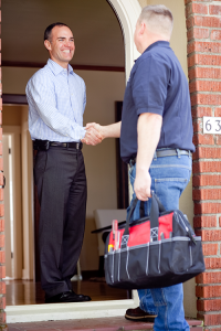 homeowner greeting a workman at his front door