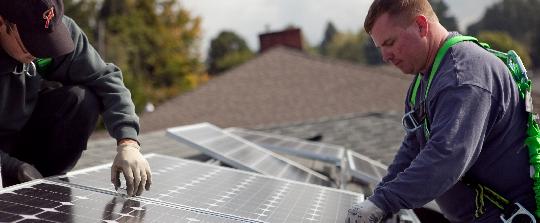 Contractors installing solar