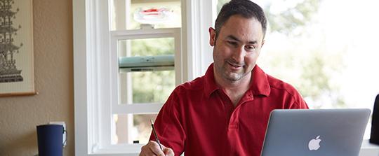 Homeowner working on laptop