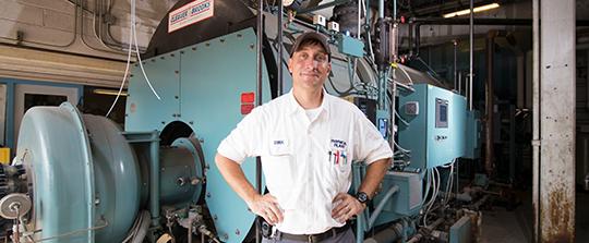 Engineer in front of equipment
