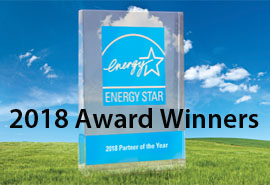 ENERGY STAR logo with 2018 Award Winners text. Blue sky and green grass in background.