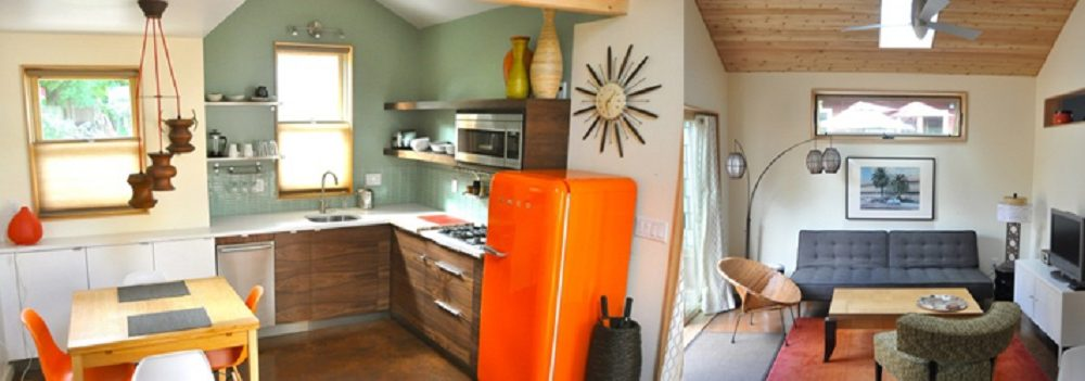 wide-angle lens photograph of a contemporary living area and kitchen