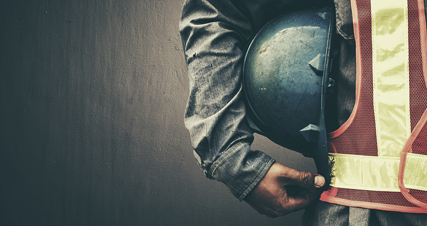 Contractor holding a blue hard hat