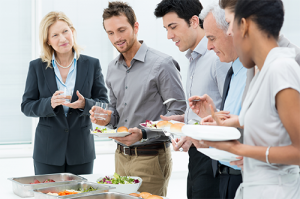 a group of people enjoying the buffet at a training seminar